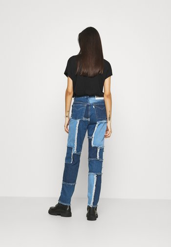CHEAT - Jeans Tapered Fit - mixed blue