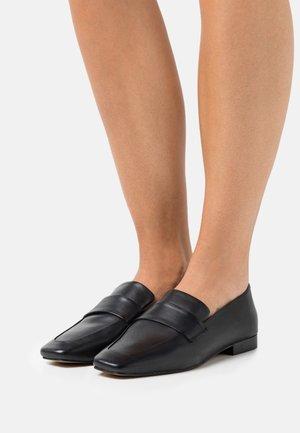 FERN - Slippers - black