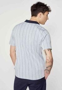 MDB IMPECCABLE - Polo shirt - blue - 1
