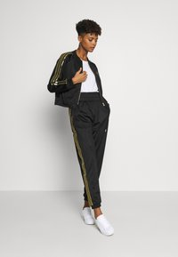 adidas Originals - SUPERSTAR 2.0 SPORT INSPIRED TRACK TOP - Treningsjakke - black - 1