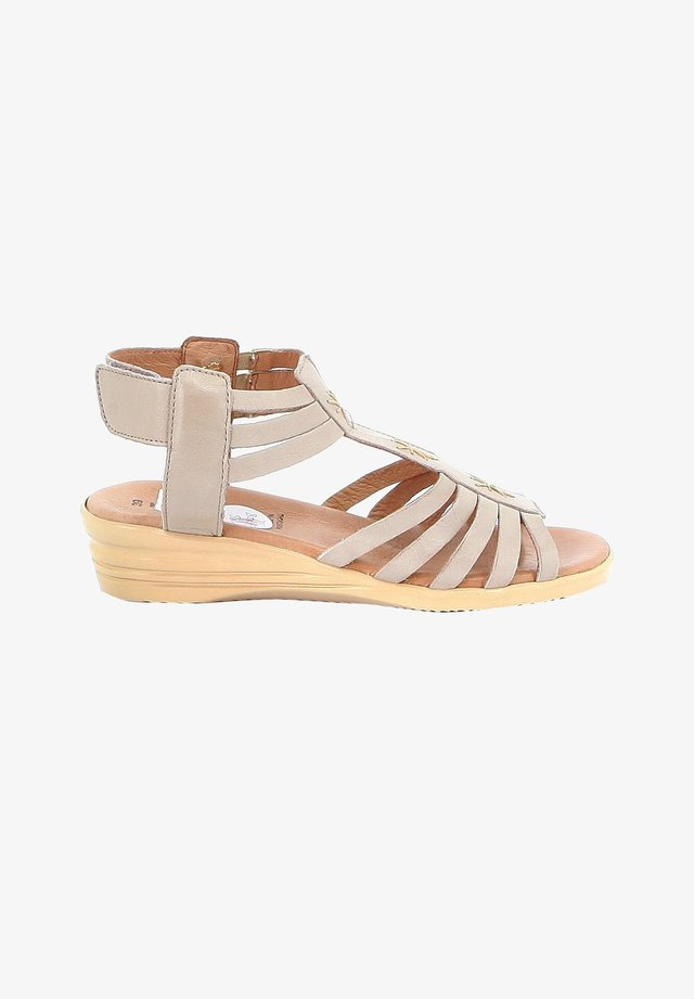FORS - Sandalen met sleehak - beige