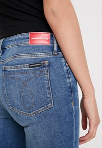 Calvin Klein Jeans - CKJ 001 SUPER SKINNY ANKLE - Skinny džíny - saxon blue release split hem - 5