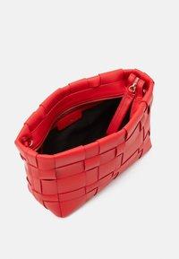 3.1 Phillip Lim - ODITA LATTICE POUCH - Across body bag - mars red - 2