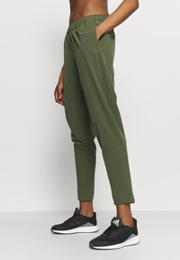 adidas Performance - TRAIN PANT - Tracksuit bottoms - olive - 3