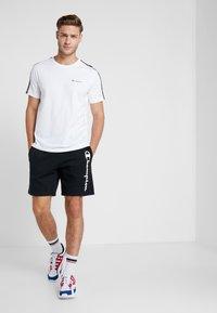 Champion - BERMUDA - Pantalón corto de deporte - black - 1