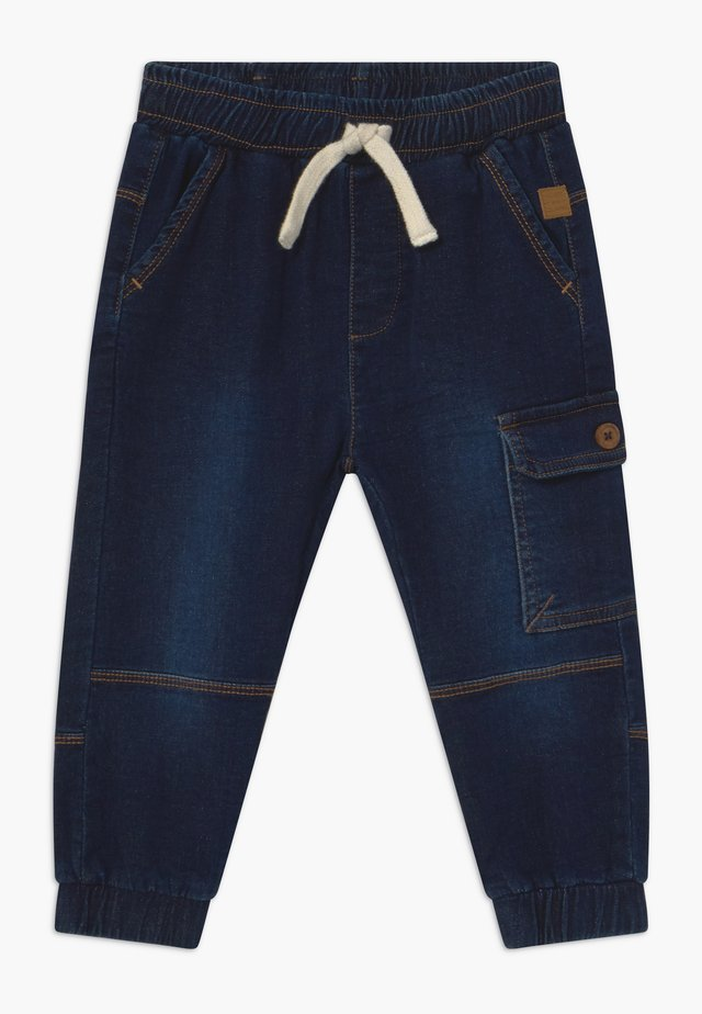 TOKE - Tracksuit bottoms - denim blue