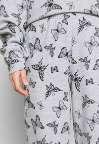 NEW girl ORDER - ACID BUTTERFLY JOGGER - Tracksuit bottoms - grey - 5