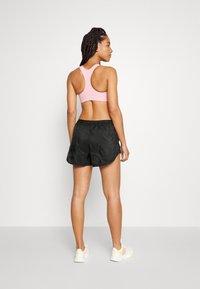 Nike Performance - RUN TEMPO LUXE  - Sports shorts - black - 2