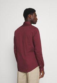 Calvin Klein Tailored - LOGO STRETCH EXTRA SLIM - Formal shirt - tawny port - 2
