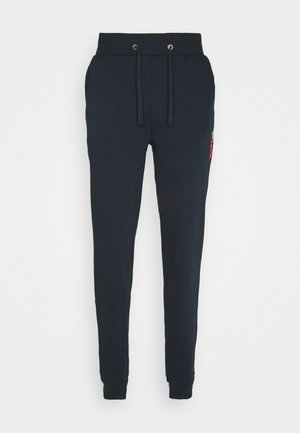 ROCKY - Tracksuit bottoms - peacoat blue