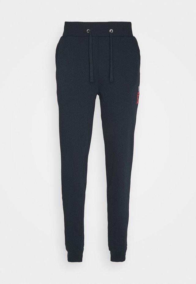 ROCKY - Pantalones deportivos - peacoat blue