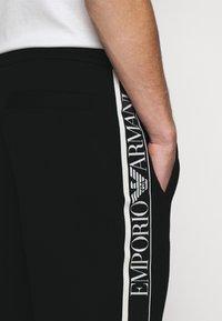 Emporio Armani - Pantaloni sportivi - black - 6