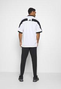 adidas Performance - STRIPES MUST HAVES SPORTS REGULAR PANTS - Verryttelyhousut - black - 2