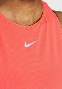 Nike Performance - TANK ALL OVER  - Sports shirt - bright mango/white - 4