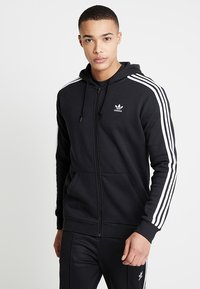 adidas Originals - STRIPES UNISEX - Huvtröja med dragkedja - black - 0