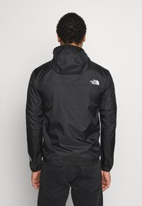 The North Face - SEASONAL MOUNTAIN  - Cortaviento - black/white - 2