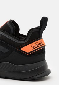 adidas Performance - TERREX HIKSTER LOW - Hiking shoes - core black/dough solid grey/signal organge - 5