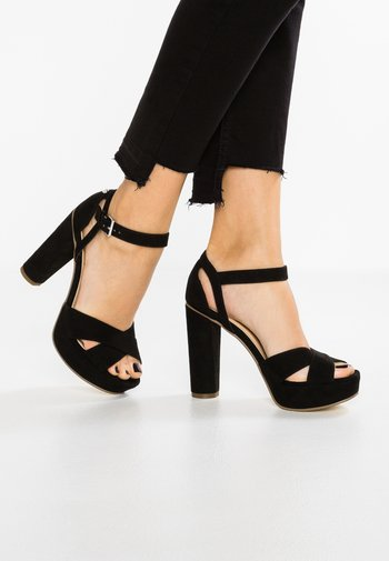 High heeled sandals