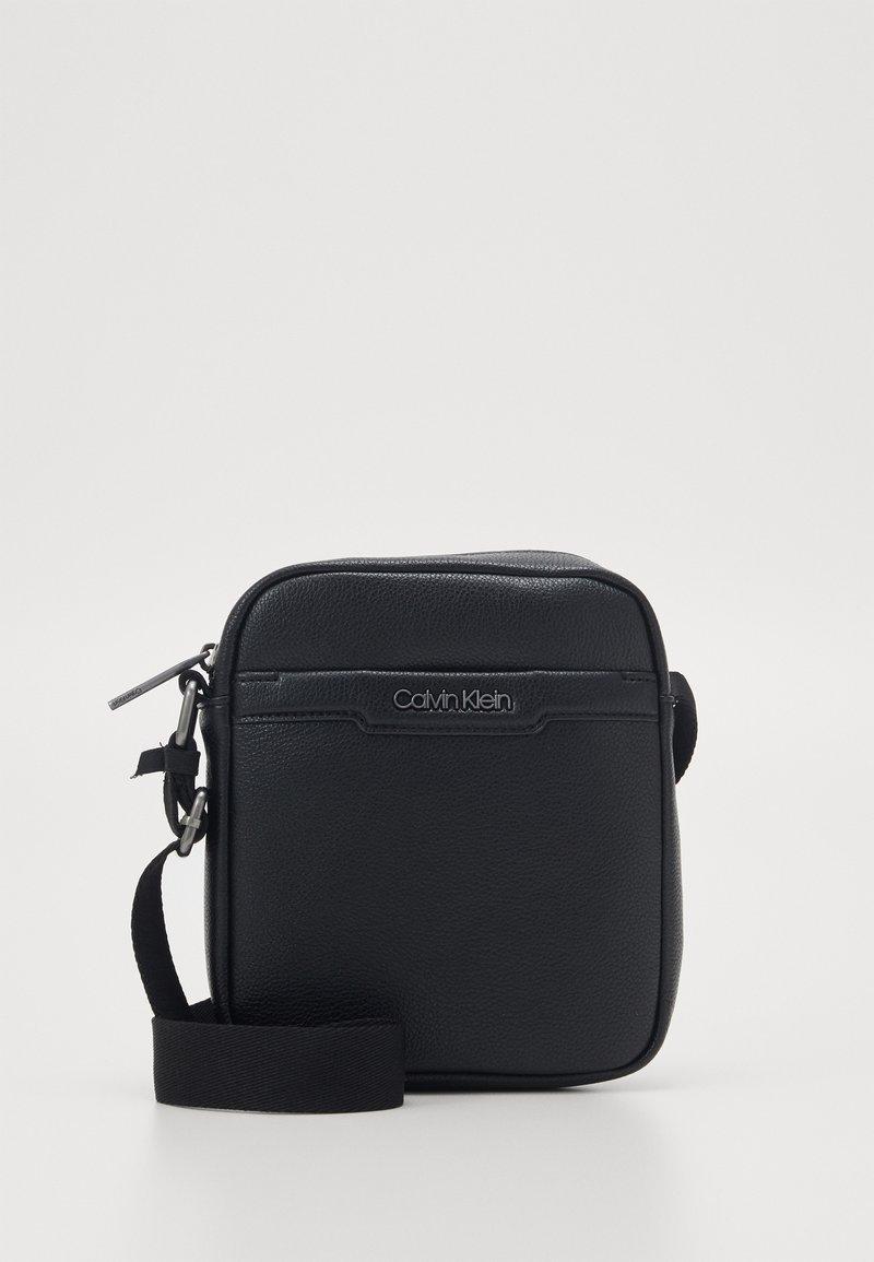 Calvin Klein - REPORTER - Across body bag - black