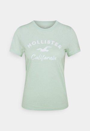 TECH CORE - Print T-shirt - light green