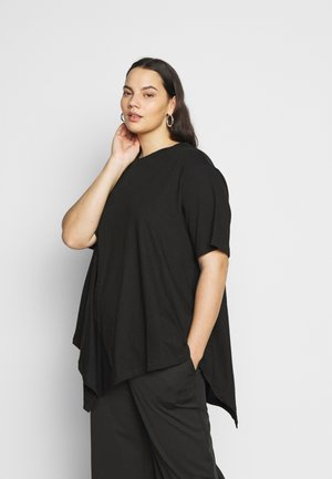 ASYMMETRIC - T-shirt con stampa - black