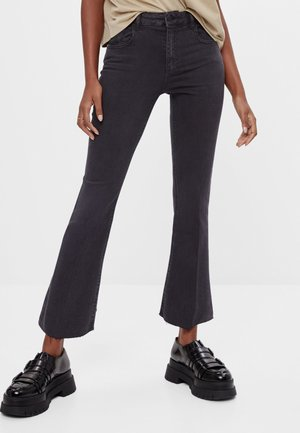 SCHLAGHOSE - Flared Jeans - black