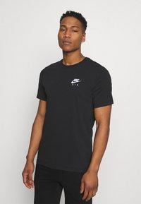 Nike Sportswear - Triko spotiskem - black - 0