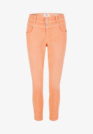 ORNELLA - Slim fit jeans - orange
