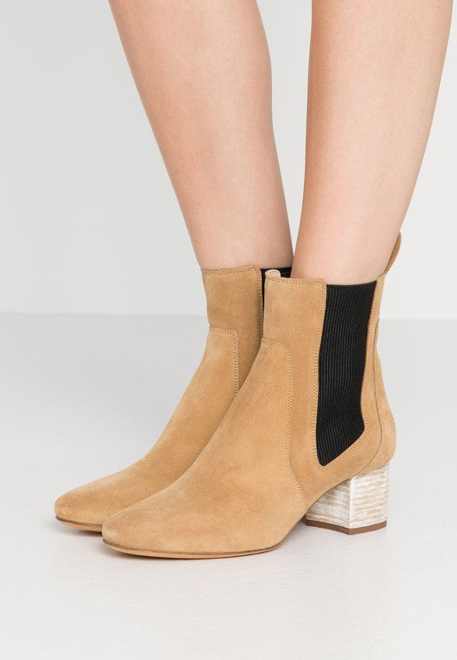 CARLY - Classic ankle boots - beige