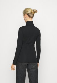 Calvin Klein Jeans - NECK ROLL NECK - Long sleeved top - black - 2
