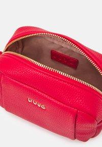 LIU JO - BEAUTY - Across body bag - true red - 2