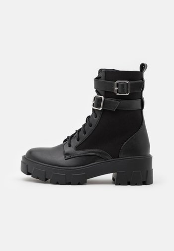 TYLIN - Lace-up ankle boots - black