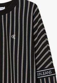 Calvin Klein Jeans - STRIPE LOGO TAPE - Sweatshirt - black - 3
