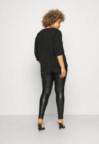 ONLY Carmakoma - CARHANNA - Leggings - Trousers - black - 2