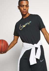 Nike Performance - DRY MEDALLION TEE - Print T-shirt - black - 3