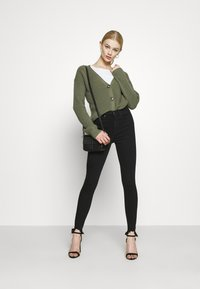 Topshop - JAGGED HEM JAMIE - Jeansy Skinny Fit - black - 1