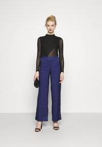 Never Fully Dressed - VOGUE - Trousers - blue - 1