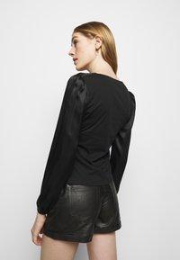 maje - LIFFANY - Long sleeved top - noir - 2