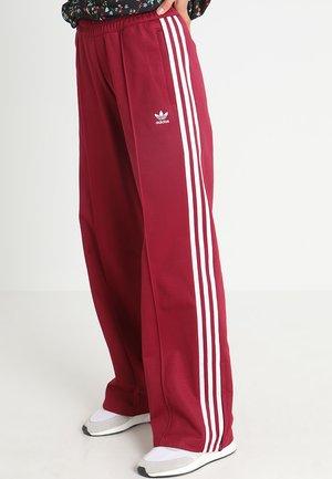 Pantalones deportivos - mystery ruby