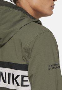 Nike Sportswear - Outdoor jacket - college grey/black - 6