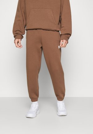 TRACKPANTS - Tracksuit bottoms - toffee