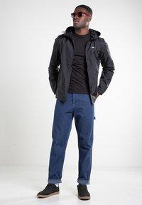 Vans - GARNETT - Training jacket - black-checkerboard - 1