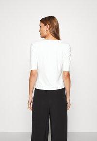 Lindex - VIRA - Camiseta básica - off white - 2