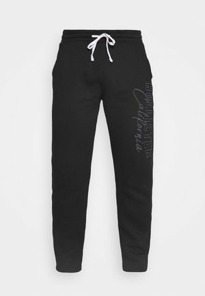 HERITAGE TECH - Tracksuit bottoms - black