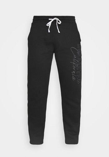HERITAGE TECH - Spodnie treningowe - black