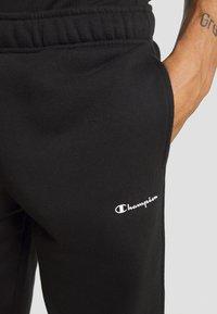 Champion - LEGACY CUFF PANTS - Teplákové kalhoty - black - 4
