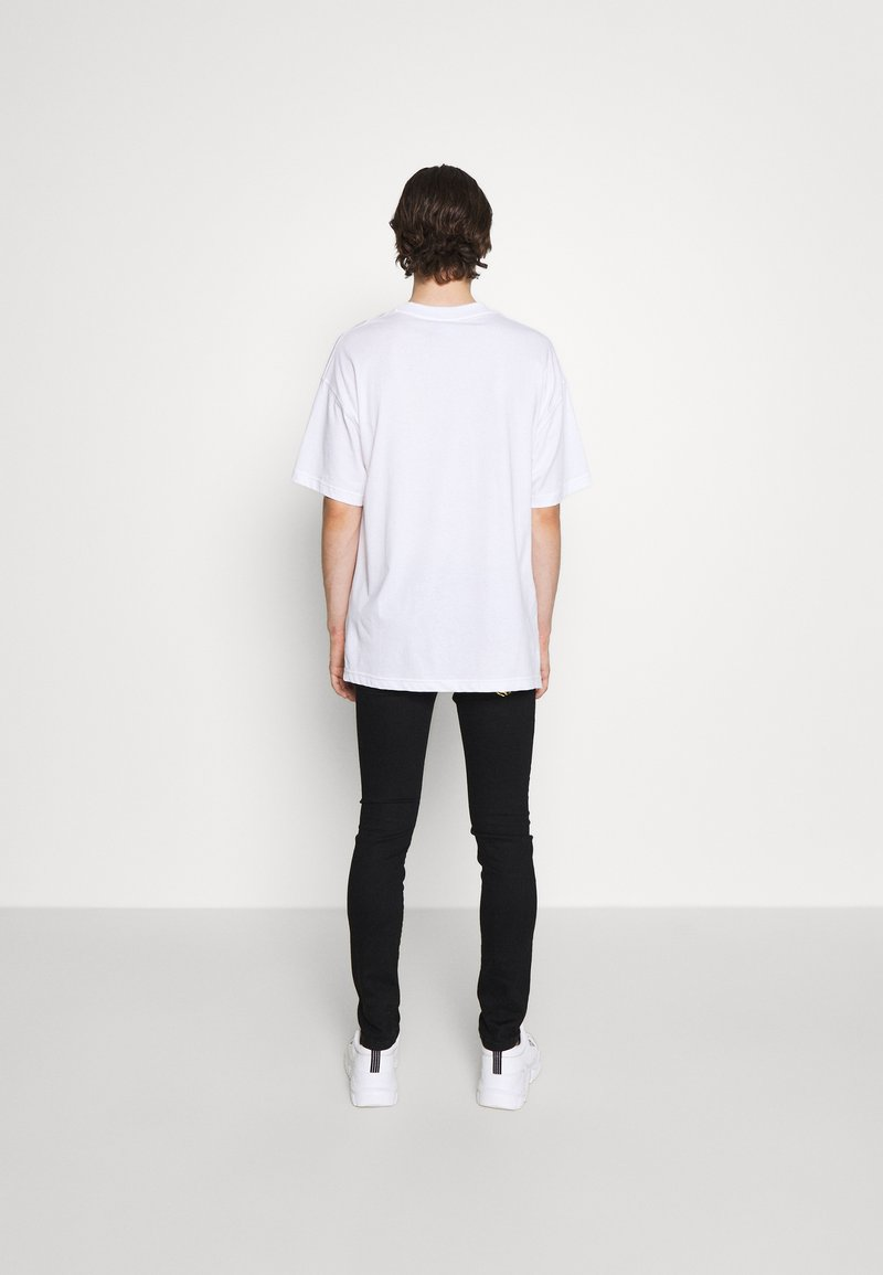 Versace Jeans Couture - RINSE - Slim fit jeans - black