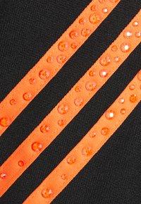 adidas Originals - SWAROVSKI TRACK UNISEX - Sportovní bunda - black/trace orange - 6