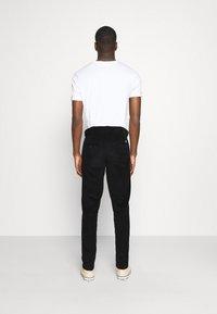 Dickies - FORT POLK - Trousers - black - 2