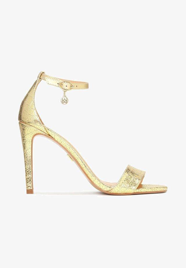 MEGAN - Sandalen met hoge hak - gold